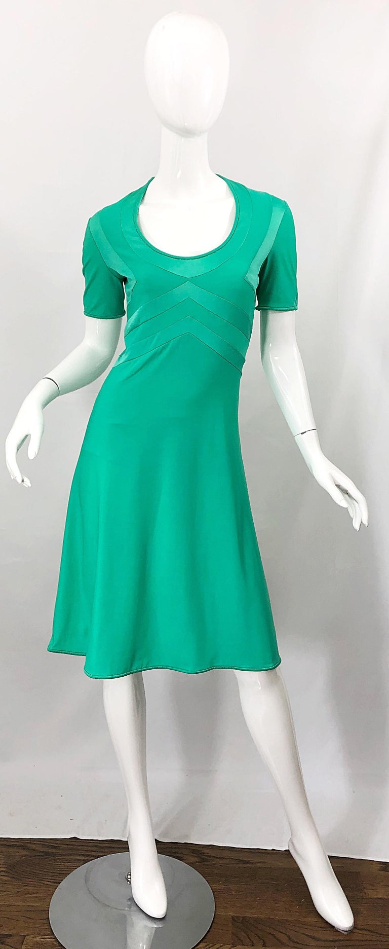 Chic mid 70s GIORGIO DI SANT ANGELO kelly green slinky short sleeve jersey bodysuit dress! Features flattering stitches on the bodice. Attactched bodysuit makes this rare gem perfect for the dance floor. Simply slips over the head and stretches to