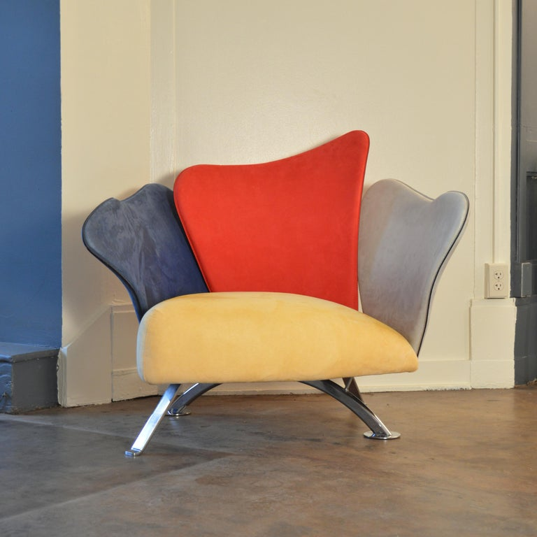 Post-Modern Flower Chair in primary color scheme, designed by Giorgio Saporiti. Made by Il Loft of Italy, circa 1990.  Each Saporiti Flower chair is completely unique. The chair's organic 'petals' are made of hand-formed steel shapes. Each piece is