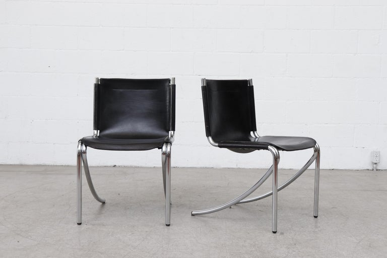 Midcentury Giotto Stoppino black leather cantilevered dining chairs with tubular chrome frames and curved leg design. Designed in 1976, these