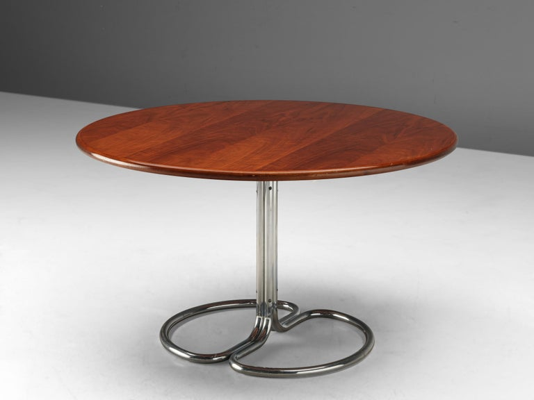 Giotto Stoppino for Bernini, 'Maia' dining table, walnut, metal, Italy, 1969  Pedestal dining table by Italian designer Giotto Stoppino for Bernini. The round tabletop shows a warm, honey colored grain of the walnut wood. It is supported by a