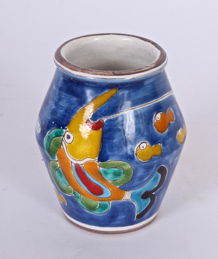 Early, signed Giovanni DeSimone for Vietri hand-painted faience Italian vase. The painted scene depicts a capped man in boat with an underwater world populated by colorful fish. With blue, green, red, orange and yellow coloration. Mediterranean.