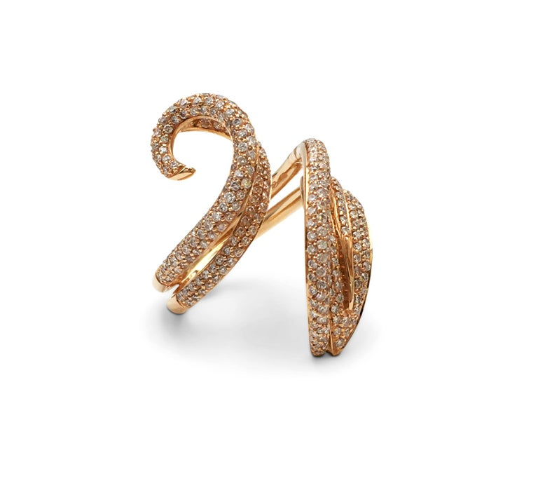 This Giovanni Ferraris crafted in 18 karat rose gold twists elegantly around the finger and set with an estimated 1.50 carats of round brilliant cut diamonds. The ring is not presented with the original box or papers. Signed Gioanni Ferrarus, 750,