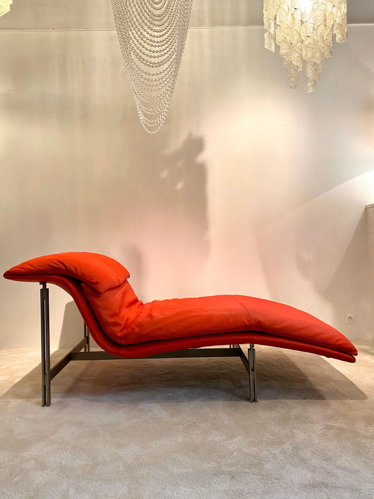 """Iconic """"Wave""""or """"Onda"""" lounge chair designed by Giovanni Offredi for the famous manufacture Saporiti Italia (signed inside). Comfortable, stylish chair executed in perforated red leather and a steel brushed structure. A beautiful movement to fit"""