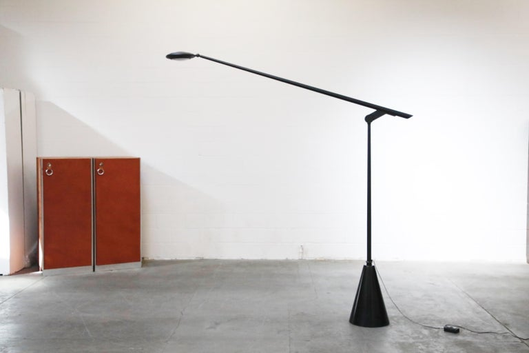 This rare Postmodern monumental 'Giraffa' floor lamp, designed and produced in 1985 for a short time, by Hans Von Klier for Bilumen features a conical granite base with matte black post and swivel arm with adjustable diffuser.  Such incredible