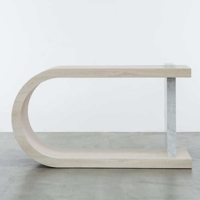 The Gisele console table is a modern console table featuring a wood or leafed curved body and marble detail. Fully custom and made to order in California. As shown in bleached white oak $15,915. Starting at $14,990.00.