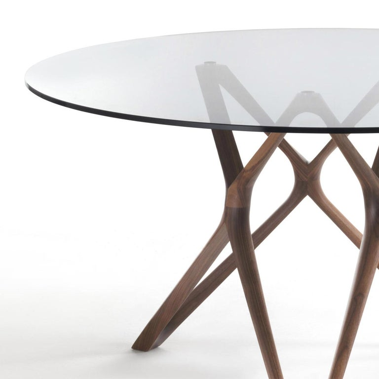 Table Giulia round with base in solid walnut wood, handcrafted wood. With tempered clear glass top (12mm thickness). Available in: Diameter 130cm x height 75cm, price: 6500,00€. Diameter 140cm x height 75cm, price: 6850,00€. Diameter 150cm x