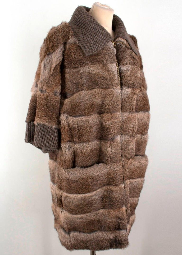 Giuliana Teso Rabbit Fur Jacket  -Fur jacket with 3/4 length sleeves -Ribbed collar and cuffs  -Two front pockets -Gold-toned zip with two zip pulls  Please note, these items are pre-owned and may show signs of being stored even when unworn and