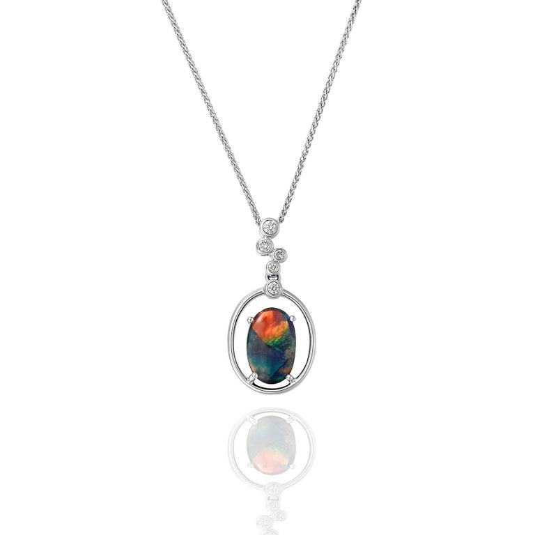 Giulians handcrafted 18 karat white gold Australian Black Opal and Diamond Pendant Necklace.  This pendant features a 1.78ct natural, solid black opal from Lightning Ridge, NSW.  The opal is set in 4 prongs within a  18 karat white gold framework.
