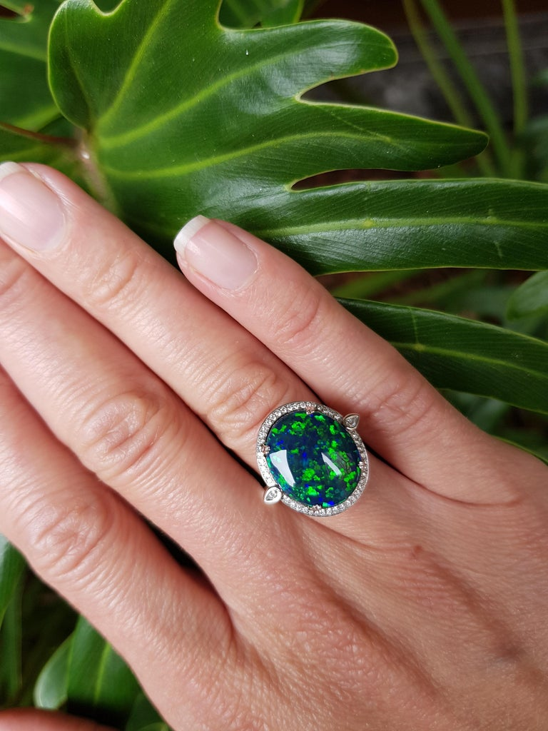 Giulians 18K 6.76ct Australian Black Opal and Diamond Halo Ring  In New Condition For Sale In Sydney, NSW