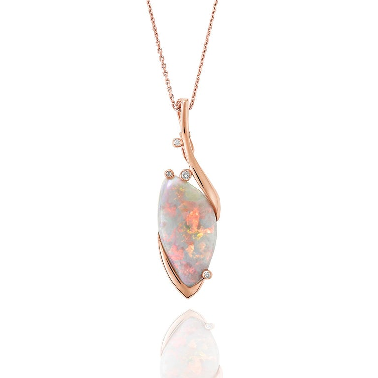 Giulians Contemporary 18 karat rose gold Australian black opal and diamond Pendant Necklace.  This pendant features a 13.60ct natural solid light black opal, from Lightning Ridge NSW, with bright pastel pink play-of-color.  The opal is set in 4