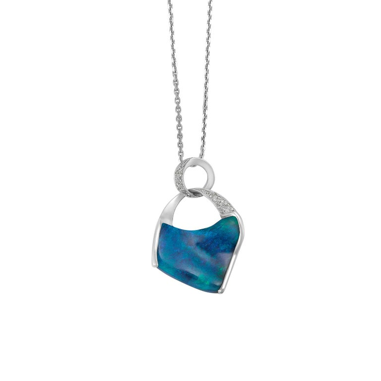 Giulians Contemporary 18 karat white gold Australian Black opal pendant necklace.  This contemporary pendant features a free-form 8.44ct natural solid opal from Lightning Ridge NSW, with bright blue and green play-of-colour.  The opal is semi bezel