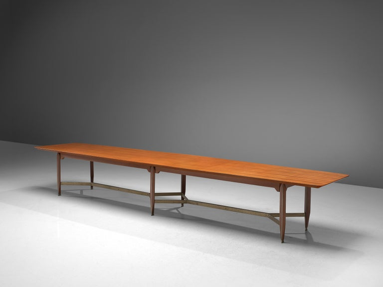 Giulio Moscatelli, conference table, teak, metal, brass, Italy, 1970s  Very large 5 meter conference table designed by Giulio Moscatelli. The tabletop is slightly boat shaped and features a notable base. The six legs are made of teak and a metal