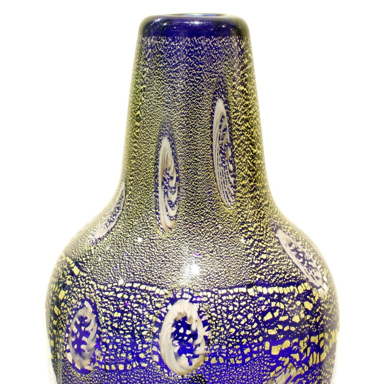 Hand blown blue glass vase with murrhines and gold foil by Giulio Radi for Arte Vetraria Muranese (A.V.E.M.), Murano, Italy, circa 1950. Radi's works are beautiful and rare. The gold foil in the glass give it a jewel-like