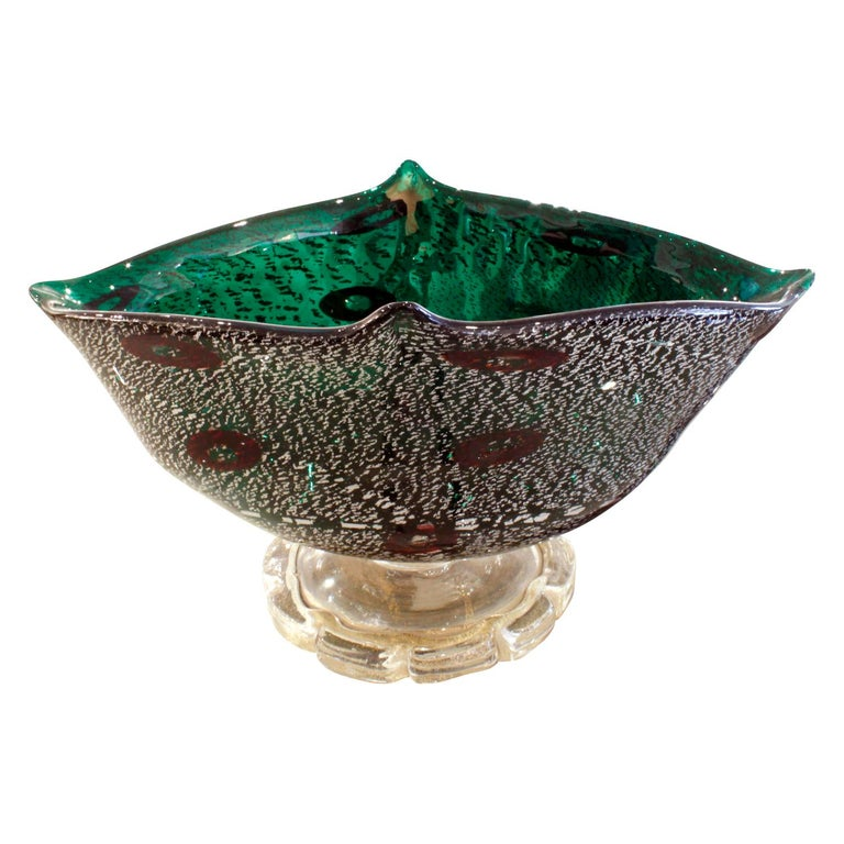 Footed vessel with base in hand blown clear glass with gold foil and body in green glass with silver foil and murrhines by Giulio Radi for Arte Vetraria Muranese (A.V.E.M.), Murano Italy, 1940s.