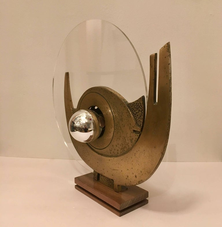 A rare 1960s Space Age bronze sculptural table lamp with a resin diffuser made by the Italian artist, Giuseppe Calonaci.