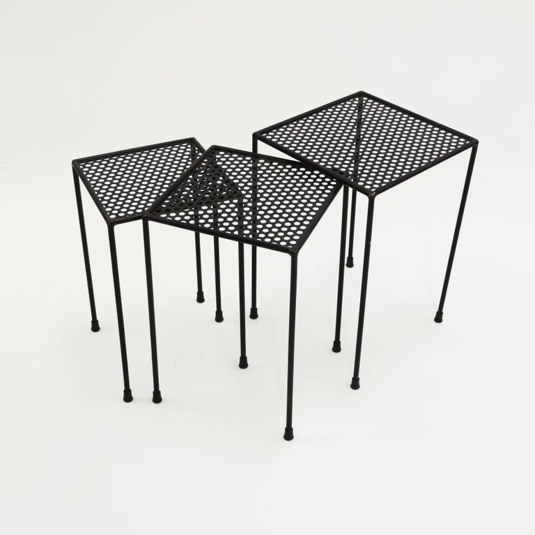 Giuseppe De Vivo nesting tables in perforated metal, Italy, 1950s.