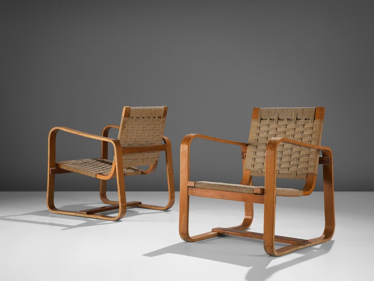 Giuseppe Pagano Pogatschnig, pair or lounge chairs, beech, natural cord, Italy, 1940  Giuseppe Pagano Pogatschnig (1896-1945) designed this bentwood armchair initially in 1940 for 'l'Università Bocconi di Milano'. Characteristic are the two