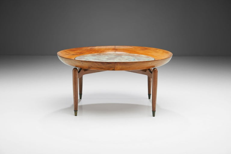 This Giuseppe Scapinelli round coffee table is made of caviuna wood and features a unique marble inlay. Scapinelli often combined ceramics and wood, and this table is among the most beautiful examples.   This rare circular coffee table has a curvy
