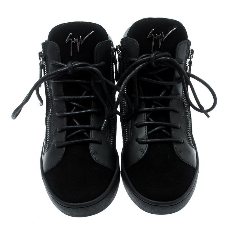 Essay your high-style in these super-stylish sneakers from the house of Giuseppe Zanotti! They are carefully crafted from suede and leather, and designed with laces on the vamps and zippers. You are sure to receive both comfort and fashion when you