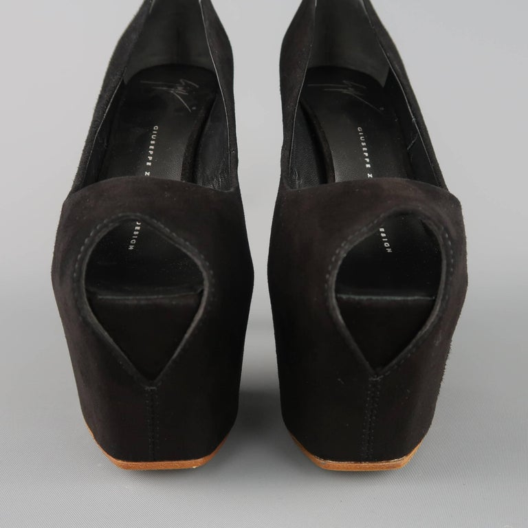 GIUSEPPE ZANOTTI pumps come in black suede with a peep toe stiletto heel, and covered high platform. Made in Italy.   New without Tags. Marked:IT 35   Measurements:   Heel: 6 in. Platform: 2.5 in.