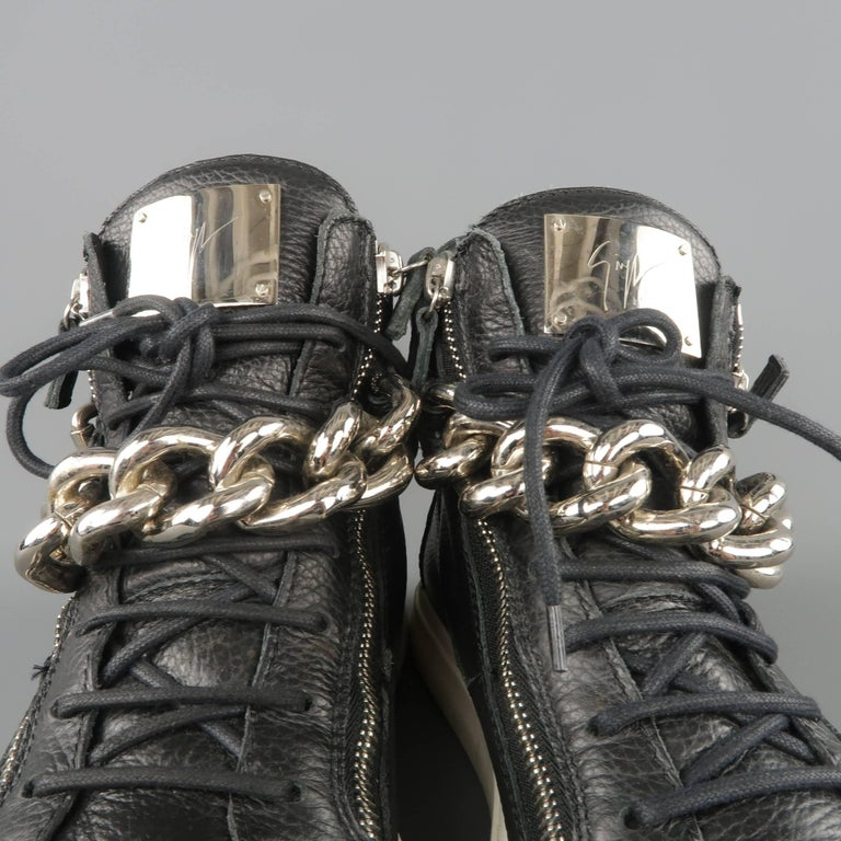 3bc7fbc298ace GIUSEPPE ZANOTTI HOMME high top sneakers come in black textured leather and  feature a lace up