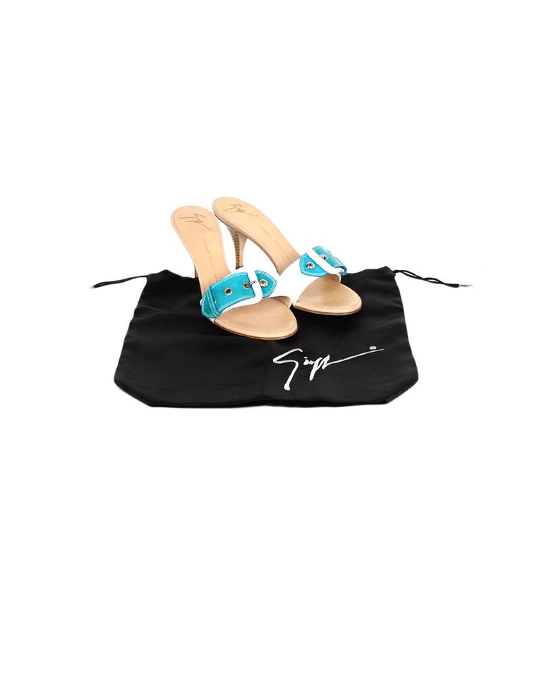 Giuseppe Zanotti White/Turquoise Patent Buckle Mules sz 39  Made In: Italy Color: White, turquoise Hardware: Silvertone hardware Materials: Patent leather Closure/Opening: Slide on Overall Condition: Excellent pre-owned condition, with minor wear to