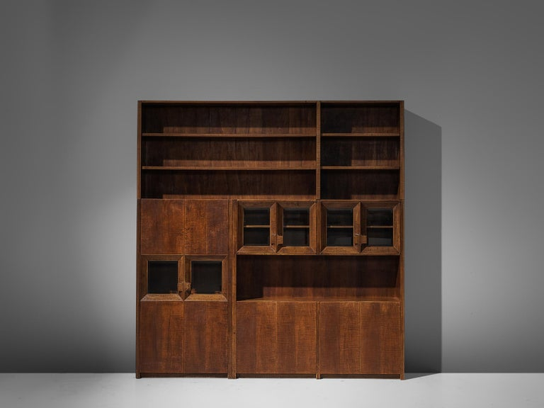 Giusseppe Rivadossi, bookcase, oak, Italy, circa 1970  An exceptional cabinet by the Italian sculptor and designer Giuseppe Rivadossi, featuring a high level of craftsmanship in woodwork. The wood is completely carved withgouge cut, which gives