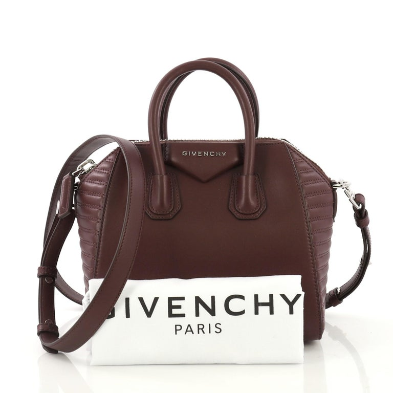 59afbf77d7 This Givenchy Antigona Bag Leather with Quilted Detail Mini, crafted from  burgundy leather with quilted