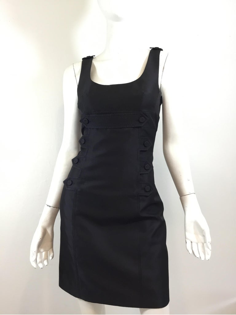 """Givenchy Dress featured in a black with decorative buttons along the front. Dress has a side zipper fastening and full lining. Size 38, made in France.   Bust 33"""", waist 30"""", hips 34"""", length 32"""""""