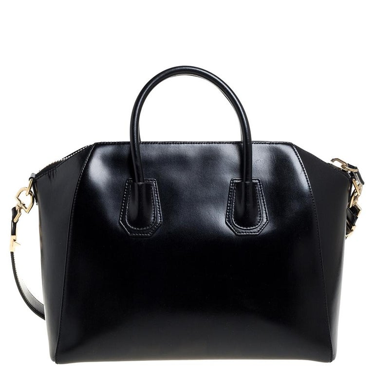 Made in Italy, and loved by women worldwide is this beautiful Antigona satchel by Givenchy. It has been crafted from leather and shaped elegantly. The black bag has a top zipper that reveals a canvas interior and it is held by two top handles and a