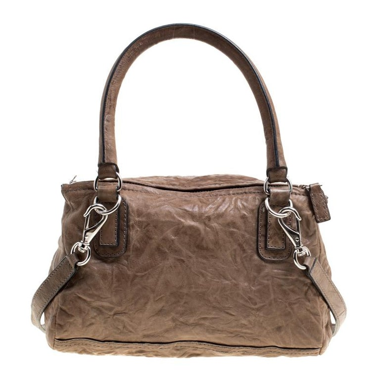 2dae90ddd4f Exhibiting a unique and interesting design, this Pandora crossbody bag from  Givenchy, carrying a