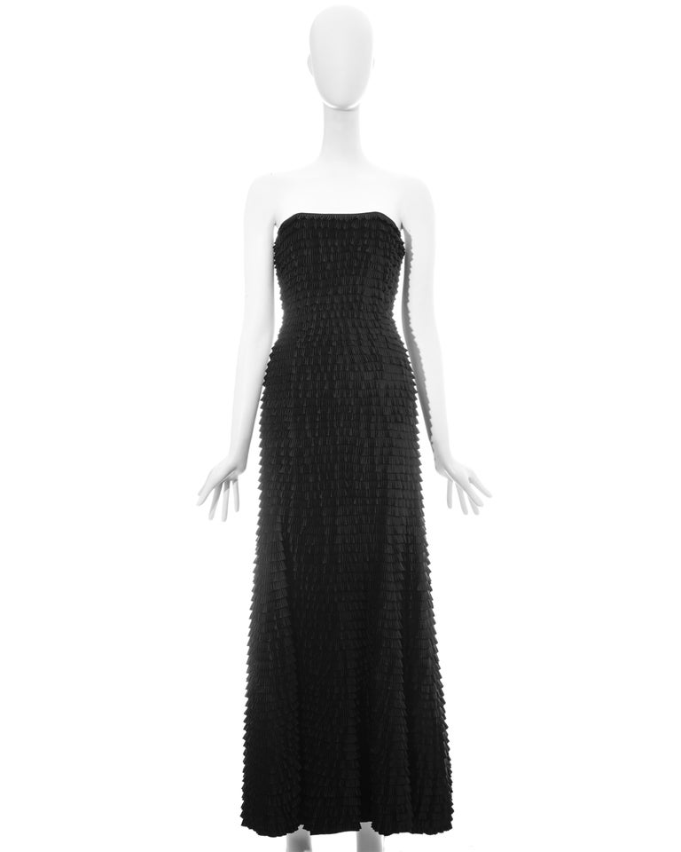 Givenchy by Alexander McQueen black ruffled fishtail strapless evening dress with built-in corset.   Spring-Summer 1999