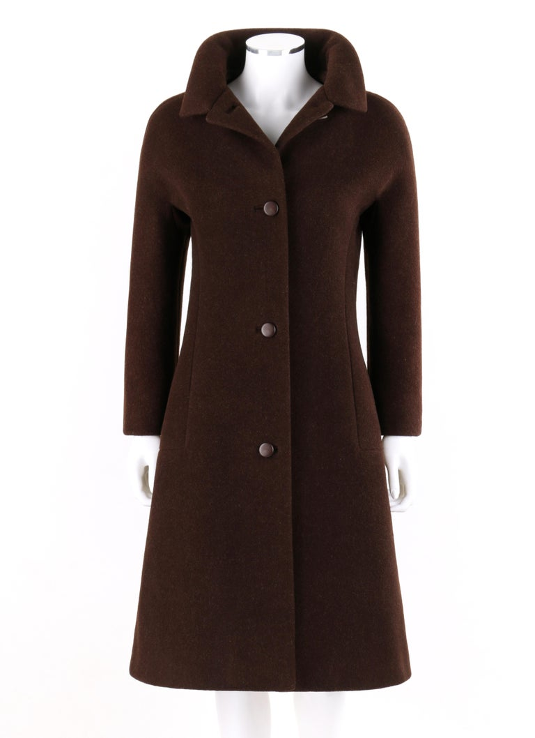 GIVENCHY c. 1960's Early Haute Couture Dark Brown Wool Princess Coat Jacket   Circa: 1960's  Label(s): Givenchy  Style: Princess Coat Color(s): Brown Lined: Yes  Unmarked Fabric Content (feel of): Exterior: Wool blend. Lining: Silk Additional
