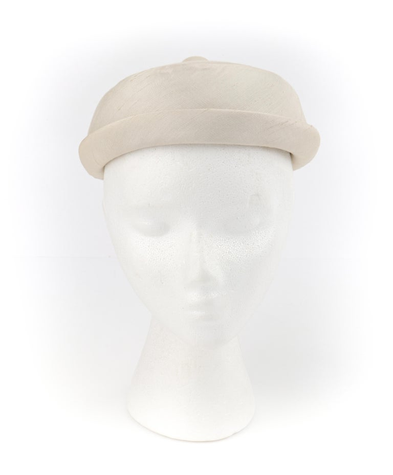 Gray GIVENCHY c.1950's Solid Cream Silk Duponi Pillbox Style Detailed Button Top Hat For Sale