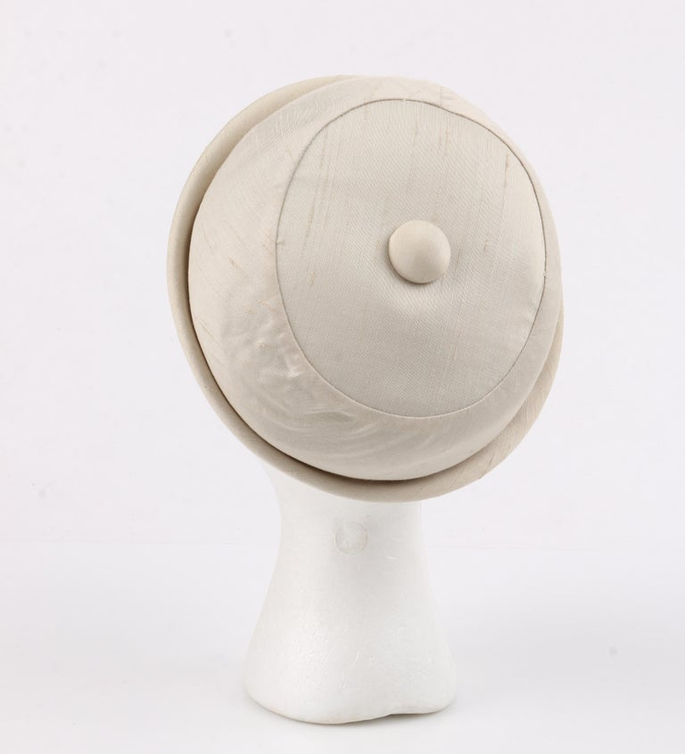 Women's GIVENCHY c.1950's Solid Cream Silk Duponi Pillbox Style Detailed Button Top Hat For Sale