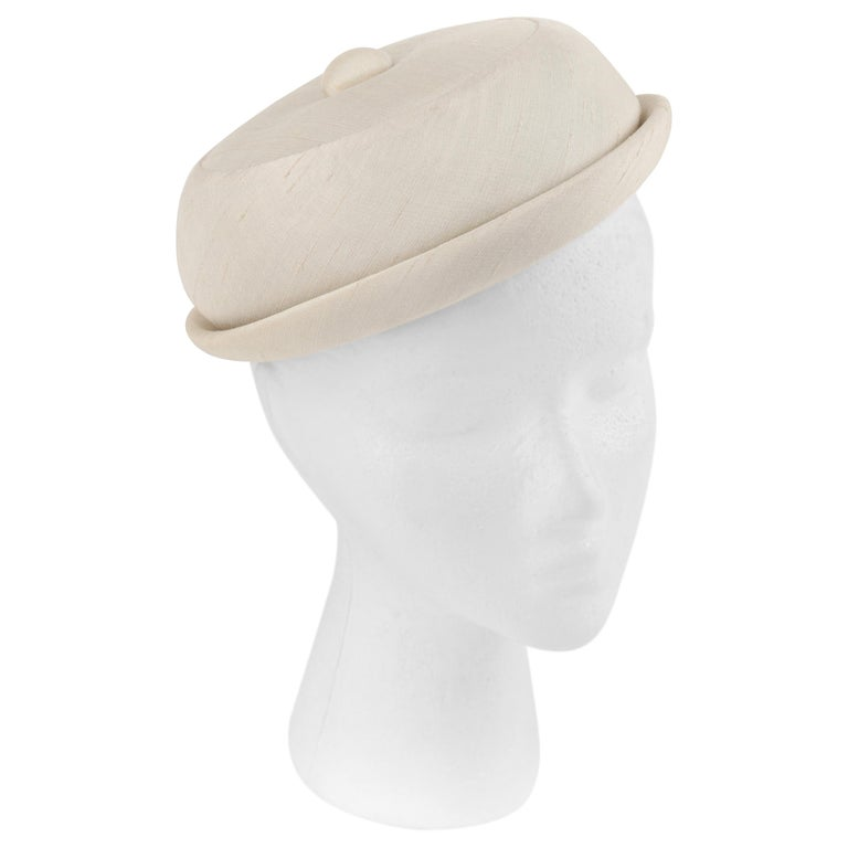 GIVENCHY c.1950's Solid Cream Silk Duponi Pillbox Style Detailed Button Top Hat For Sale