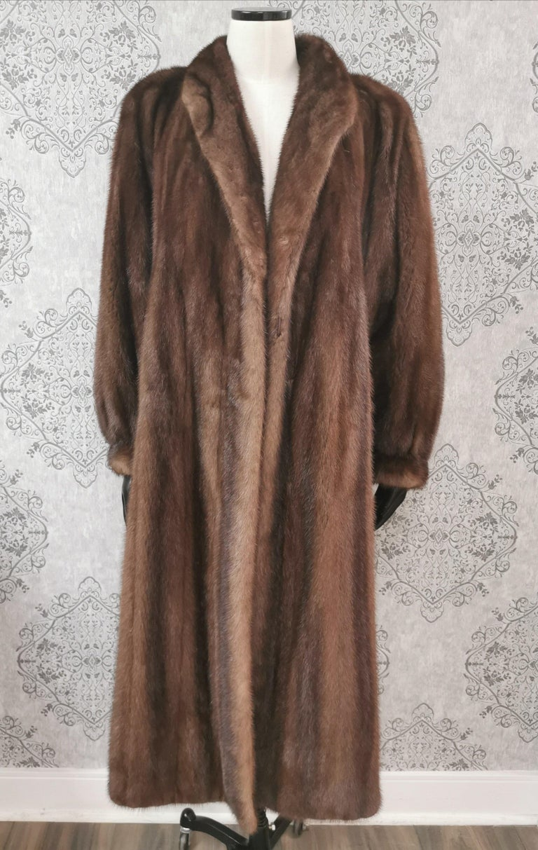 Givenchy Haute Fourrures Demi Buff with Female Mink Fur Coat in excellent condition (Size 12 - M)  Portrait collar with princess cuffs and European German clasps for closure, two slit side pockets and full silk satin lining.   Made in