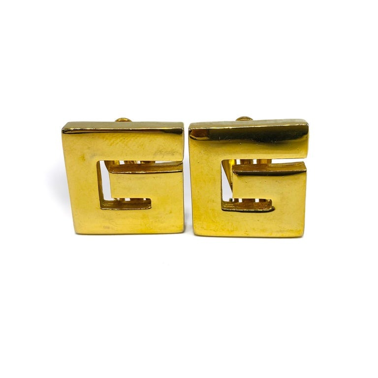 Givenchy Vintage 1980s Clip On Earrings  Super cool 'G' earrings from the iconic House of Hubert de Givenchy  Detail -Made in the 1980s -Crafted from gold plated metal -A large 'G' for Givenchy  Size & Fit -7/8 inch across -Clip on
