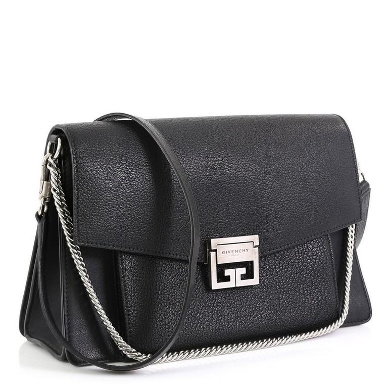 This Givenchy GV3 Flap Bag Leather Medium, crafted in black quilted leather, features removable chain and leather shoulder strap, flap top with logo-engraved flip-lock closure, exterior front zip and slip compartments and silver-tone hardware. Its