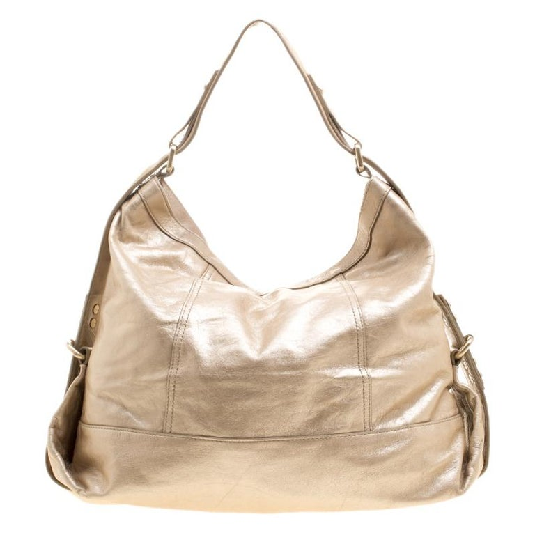 For the ones who love bling and cannot live without it comes the Givenchy Metallic Gold Leather Hobo. A spacious interior that can carry almost all your necessities is covered by a shiny metallic leather exterior and closed by a zipper. This bag is