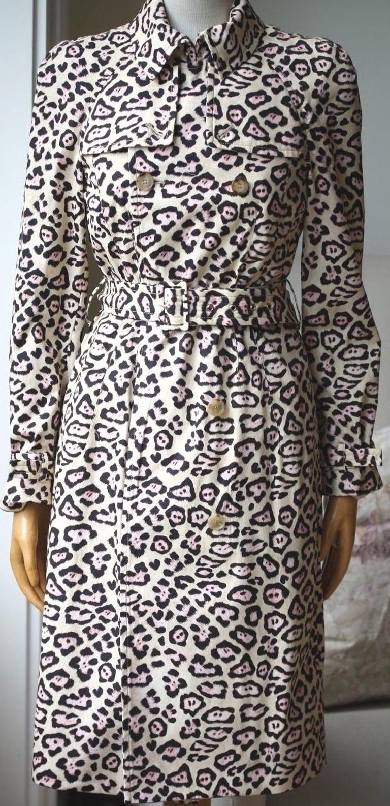 Beige, black and pink oversize leopard print coat from Givenchy featuring a drawstring hood, a concealed zip fastening, short wide sleeves, front flap pockets and a straight hem. 100% polyamide, 53% acrylic, 47% polyester, lining: 100% polyamide.