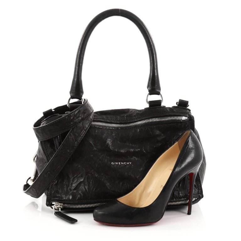 a4ffc62fb514 This authentic Givenchy Pandora Bag Distressed Leather Medium is the  perfect companion for any on-