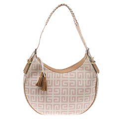 eb51aef5134 Givenchy Ivory Tinhan Ostrich Leather With Two Side Zippers Hobo Bag ...