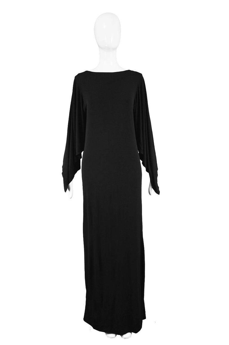 """Givenchy Vintage 1970s Nouvelle Boutique Black Jersey Maxi Column Dress  Estimated Size: UK 12-14/ US 8-10/ EU 40-42. Please check measurements  Bust - 38"""" / 96cm  Waist - 34"""" / 86cm (meant to have a loose fit) Hips - 42"""" / 106cm Length (Shoulder to"""