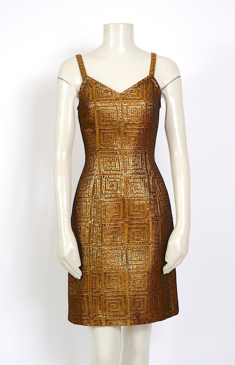 Givenchy vintage gold logo dress that dates from the 90s or 80s  Fully lined.  Made in France Excellent condition  Closes at the back with a zipping. The fabric is a mix of metal - viscose, and polyester There is no size label, and we fitted the