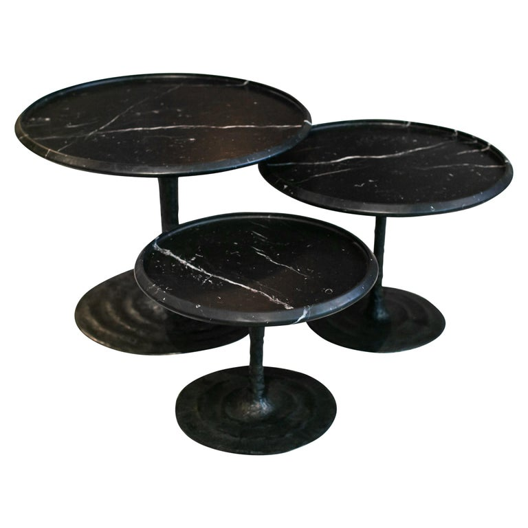 Edition signed, the Giverny tables are a series of nesting coffee tables inspired by the ne´nuphars (waterlilies) of Monet's house in Giverny. The movement carved at the bronze foot evoke the water movement. Their elegant silhouettes and detailed