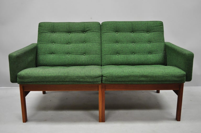 Gjerlov Knudsen & Torben Lind for France & Son green teak Moduline loveseat sofa. Item features original green button tufted upholstery, exposed joinery, solid wood construction, beautiful wood grain, original label, clean modernist lines, circa