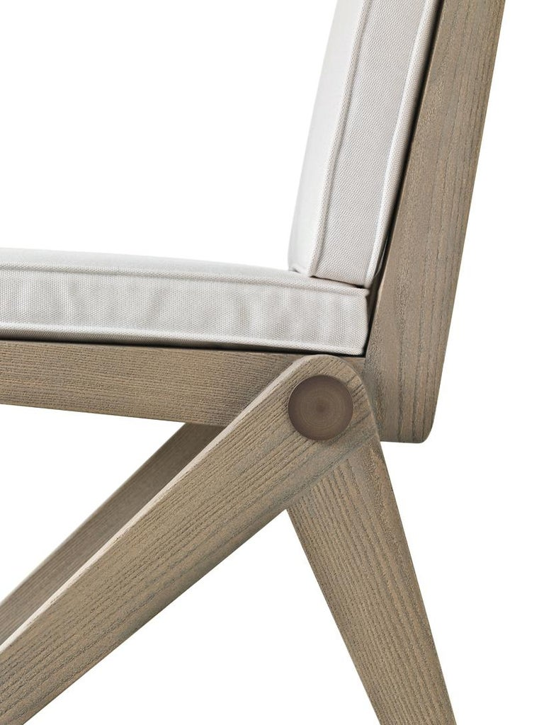 """Glade dining chair. designed by Archer & Humphryes, is inspired by the geometric lines and essential characteristics of some chairs from the fifties. The peculiarity of Glade is represented by the legs designed as inverted """"V""""s which are off center"""