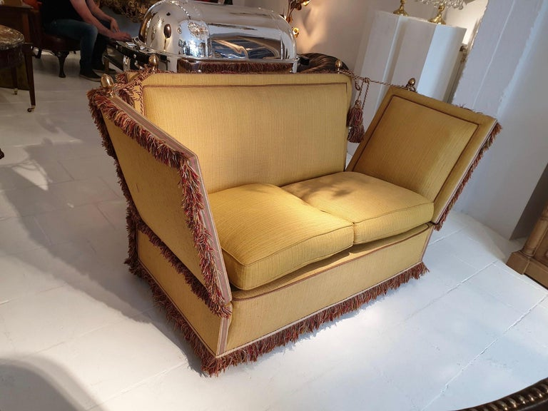 Very glamorous Classic Knole style sofa upholstered in a beautiful soft shade of goldish yellow fabric. The Knole sofa or settee originated in England in the late 1700s and is still being produced to this day which says something about the Classic