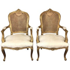 Glamorous Pair of French Louis XV Style Gold Gilt Caned Bergères Armchairs